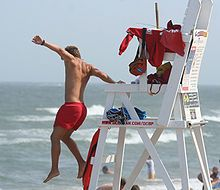 220px-Lifeguard_jumping_into_action,_Ocean_City,_June_27_,2007