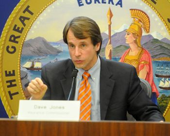 State Insurance Commissioner Dave Jones talks with fire victims Thursday.