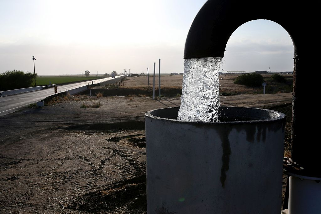 TULARE, CA - APRIL 24: Well water is pumped from the ground on April 24, 2015 in Tulare, California. As California enters its fourth year of severe drought, farmers in the Central Valley are struggling to keep crops watered as wells run dry and government water allocations have been reduced or terminated. Many have opted to leave acres of their fields fallow. (Photo by Justin Sullivan/Getty Images)
