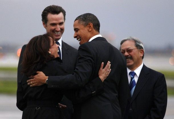 U.S. President Barack Obama is greeted by California Attorney General Kamala Harris (L), California Lieutenant Governor Gavin Newsom (2nd L) and San Francisco Mayor Edwin Lee (R) upon his arrival in San Francisco February 17, 2011. Obama is visiting nearby Woodside to meet with business leaders in technology and innovation, including Apple Inc Chief Executive Steve Jobs, at a private residence.  REUTERS/Kevin Lamarque (UNITED STATES - Tags: POLITICS)