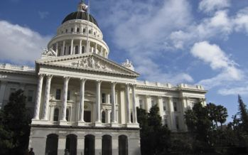 California faces revenue surplus, persistent debt