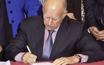 Gov. Brown signs major bills, including ones that expand workplace benefits